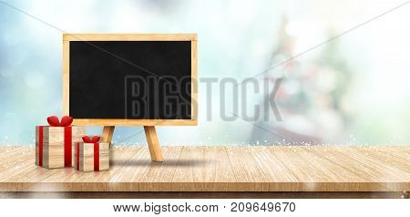 Blank Blackboard With Gift Box On Wood Table Top With Christmas Tree Blurred Bokeh Light White Falli