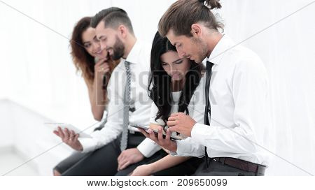 Business workers using a digital tablet.