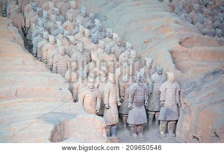 XIAN, CHINA - October 8, 2017: Famous Terracotta Army. The mausoleum of Qin Shi Huang, the first Emperor of China contains collection of terracotta sculptures depicting the armored men and horses.