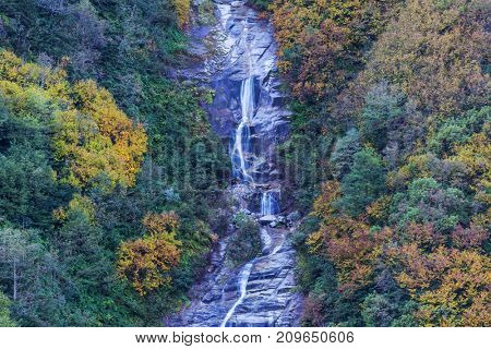 Picturesque autumn waterfall