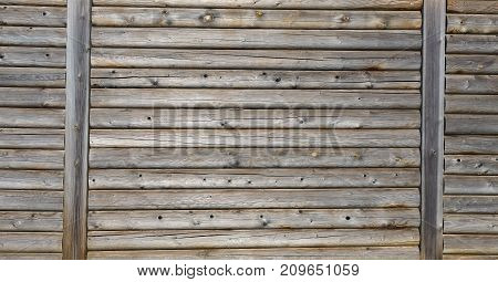 Wooden wall. Part of the Wall made of Wooden Logs