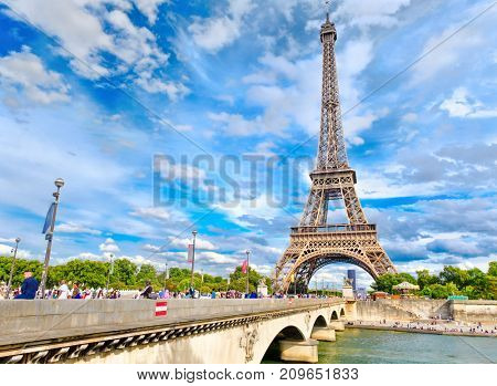PARIS,FRANCE - JULY 30,2017 : The Eiffel Tower and the river Seine in Paris on a beautiful summer day