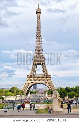 PARIS,FRANCE - JULY 30,2017 : Street scene in Paris with traffic and tourists next to the Eiffel Tower