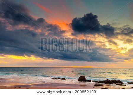 Dramatic sunset over rocky beach South Australia