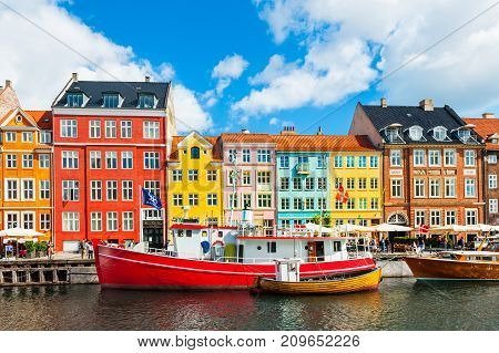 Nyhavn Pier With Colorful Buildings In Copenhagen, Denmark