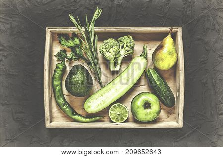 A Set Of Green Vegetables And Fruits In A Wooden Box