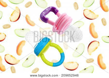 Baby nibblers and sliced fruits on white background