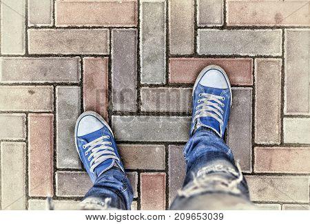 Legs In Blue Sneakers