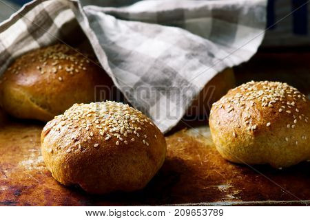 HOMEMADE SOFT WHOLE WHEAT BURGER BUNS.. Style rustic. selective focus