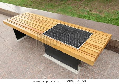 Bench with solar panel on street