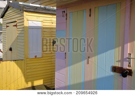 WHITSTABLE, UK - OCTOBER 15, 2017: Close-up on the entrance of colorful wooden huts