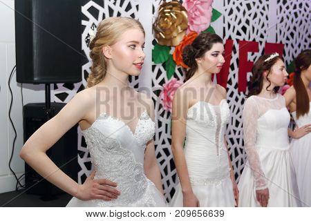 PERM RUSSIA - FEB 12 2017: Pretty model bride stand on catwalk at Wedding Fair Perm 2017
