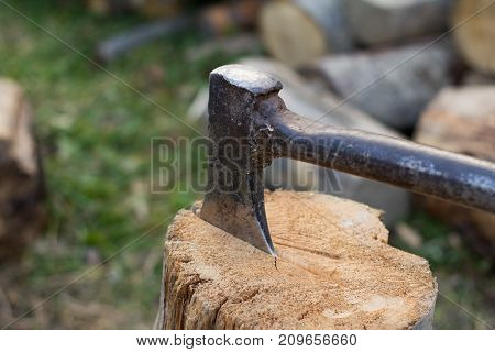 Close up piture of chopping firewood, country photo with wood and axe