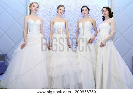 PERM RUSSIA - FEB 12 2017: Beautiful models brides pose at Wedding Fair Perm 2017