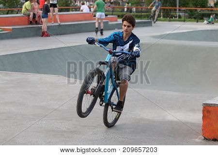 PERM RUSSIA - JUL 29 2017: Extreme cyclist trains in Extreme park Perm Extreme Park was opened on October 10 2009 it is analogue of Louisville Extreme Park
