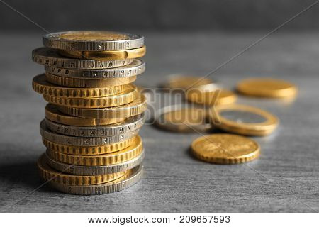 Stack of coins on grey background
