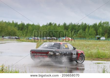 PERM RUSSIA - JUL 22 2017: Drifting car in puddle at Open Ural Championship Drift 2017
