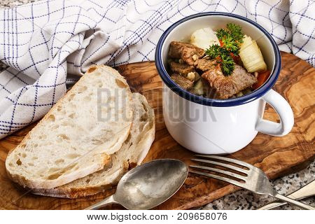 irish beef and barley stew served in a blue and white enamel mug