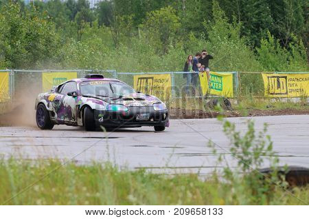 PERM RUSSIA - JUL 22 2017: Drifting car with smoke at Open Ural Championship Drift 2017
