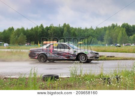 PERM RUSSIA - JUL 22 2017: Drifting modern car move on wet asphalt track at Open Ural Championship Drift 2017