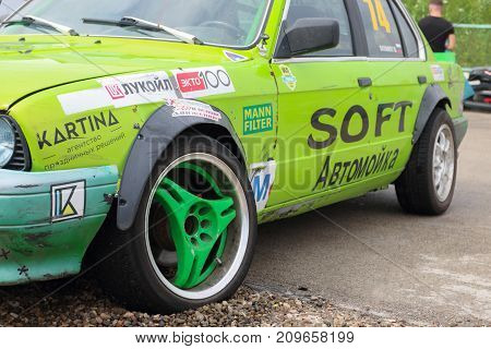PERM RUSSIA - JUL 22 2017: Green competitor car with sponsors advertising at Open Ural Championship Drift 2017