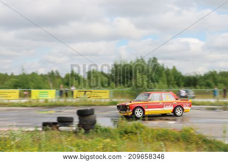 PERM RUSSIA - JUL 22 2017: Drifting red car on race track at Open Ural Championship Drift 2017
