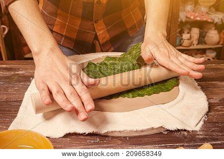 Woman Potter Sculpts Clay