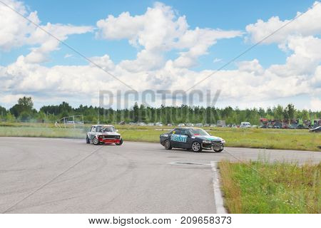 PERM RUSSIA - JUL 22 2017: Two drifting cars on track Open Ural Championship Drift 2017
