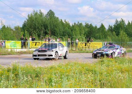 PERM RUSSIA - JUL 22 2017: Two drifting cars compete on track Open Ural Championship Drift 2017
