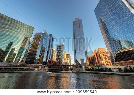 Chicago Skyline. Chicago downtown and Chicago River with bridges at sunset.