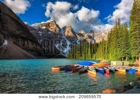 Canoes on Moraine lake at sunrise, Banff national park in the Rocky Mountains, Alberta, Canada.