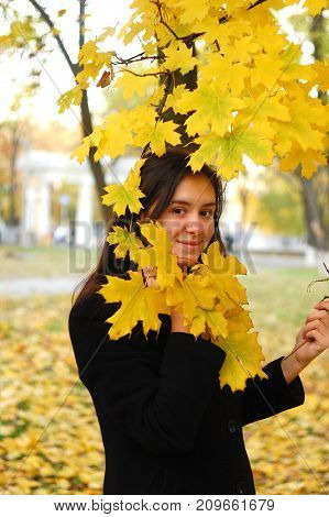 A Portret Of Happy Young Attractive Girl In An Autumn Park. Cheerful Emotions, Autumn Mood
