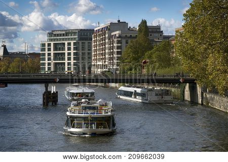 Berlin Germany - October 8 2017: Tourist boats on Spree River in the middle of Berlin October 8 2017.