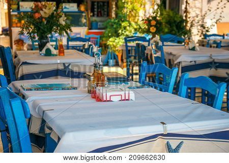 White and blue colors of traditional Greek tavern. Crete Island Greece