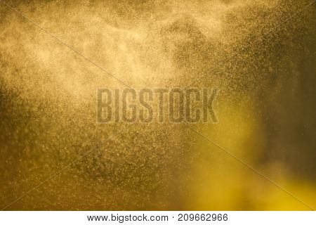 Background - splashes of water in backlighting from the setting sun