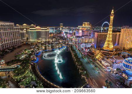 Las Vegas strip skyline at night on July 25, 2017 in Las Vegas, Nevada. Aerial view of beautiful Bellagio fountains show in Las Vegas, USA.