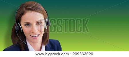 Close-up of smiling woman talking on microphone headset against green abstract background