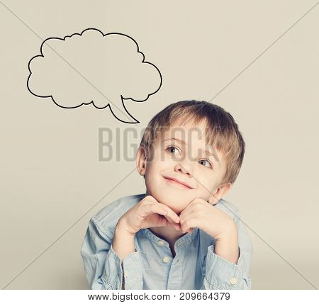 Smiling Child Boy Dreaming on Background with Copy space. Ideas and School Concept