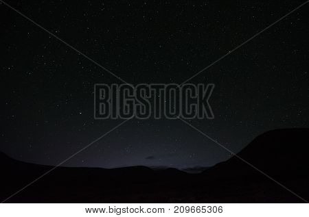 Night sky with bright stars the Milky Way and flying meteorite