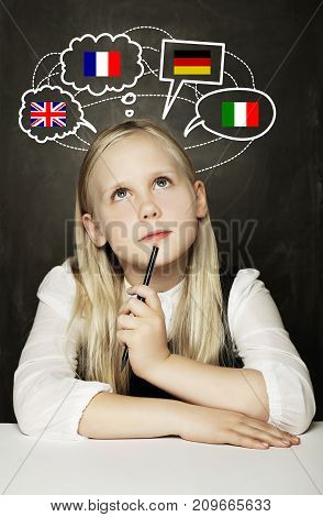 School Girl Pupil Learning English German French or Italian Language on the Blackboard Background with United Kingdom Germany Italy France Flags