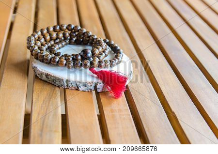 Wooden mala beads traditionally used in prayer and meditation. Essential accessory for mindfulness or concentration.