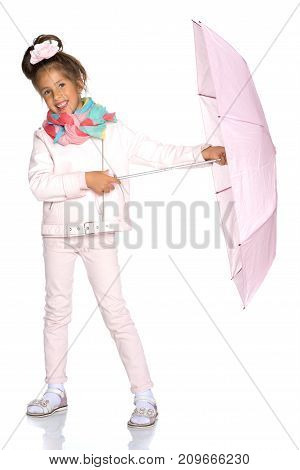 A nice little girl hid under an umbrella. The concept of a happy childhood, outdoor recreation, protection from bad weather. Isolated on white background.