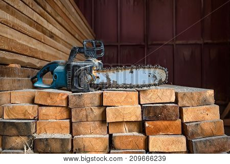 Used professional chainsaw on timber or wooden background