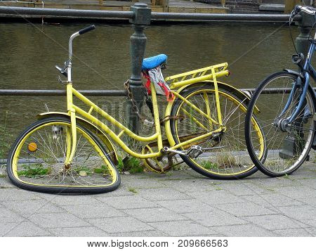 A bicycle is a wheeled vehicle driven by the muscular force of a person through the foot pedals