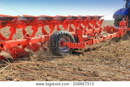 details of the combine harvester in the field. Close-up
