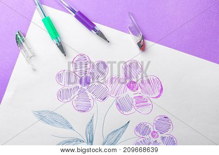 Child's drawing of beautiful flowers on color background, closeup