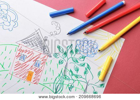 Child's drawing of house and trees on color background, closeup