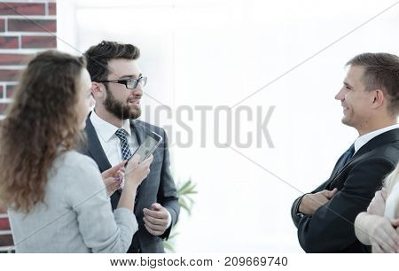 business partners communicating before the start of the official meeting