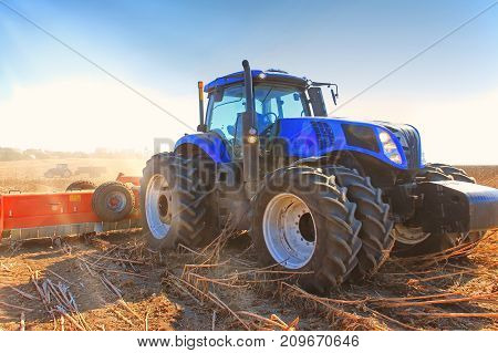 Close-up Work Of A Tractor On A Wheat Field