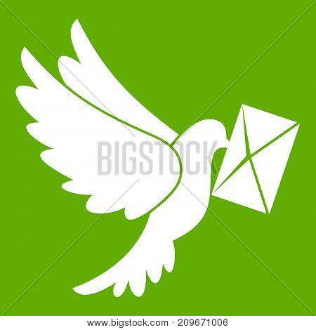Dove carrying envelope icon white isolated on green background. Vector illustration